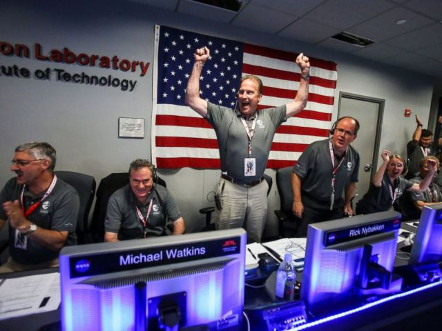 PHOTO: From left to right, Geoffrey Yoder, Michael Watkins, Rick Nybakken, Richard Cook and Jan Chodas celebrate in Mission Control at NASAs Jet Propulsion Laboratory as Juno goes into orbit around Jupiter on July 4, 2016, in Pasadena, California.