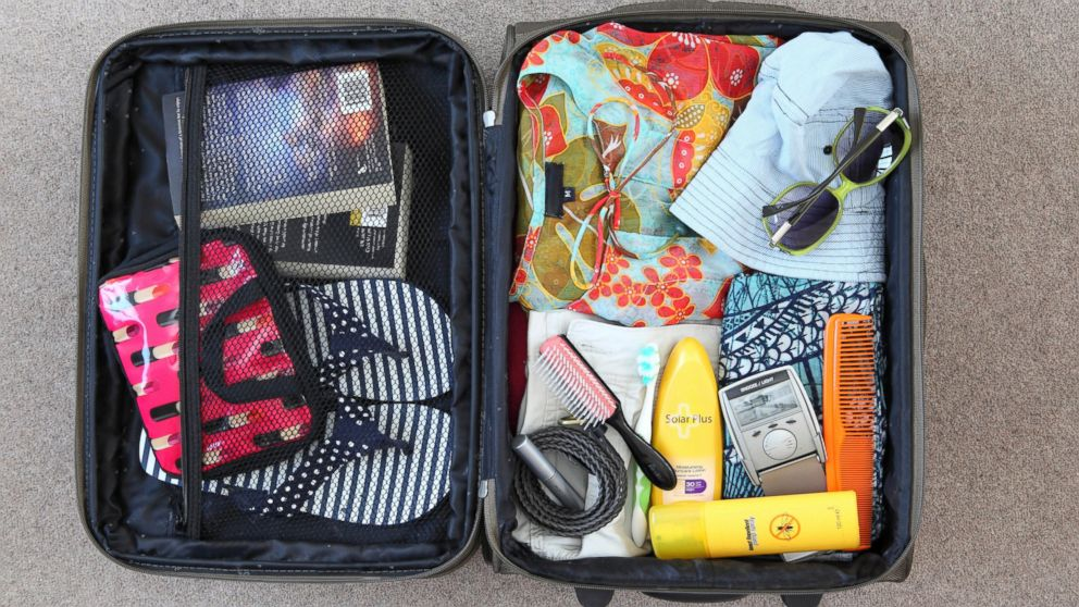 Image result for people packing luggage