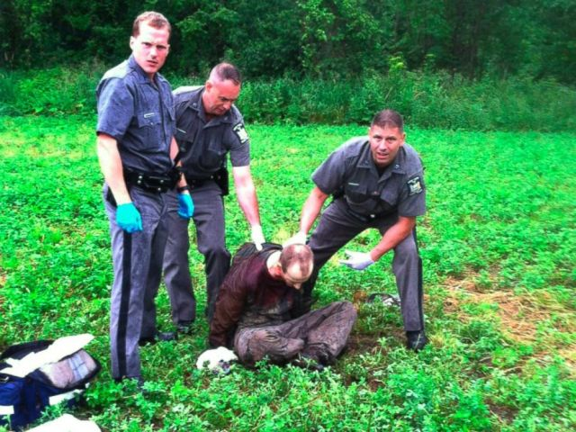 PHOTO: Police stand over David Sweat after he was shot and captured near the Canadian border, June 28, 2015, in Constable, N.Y.