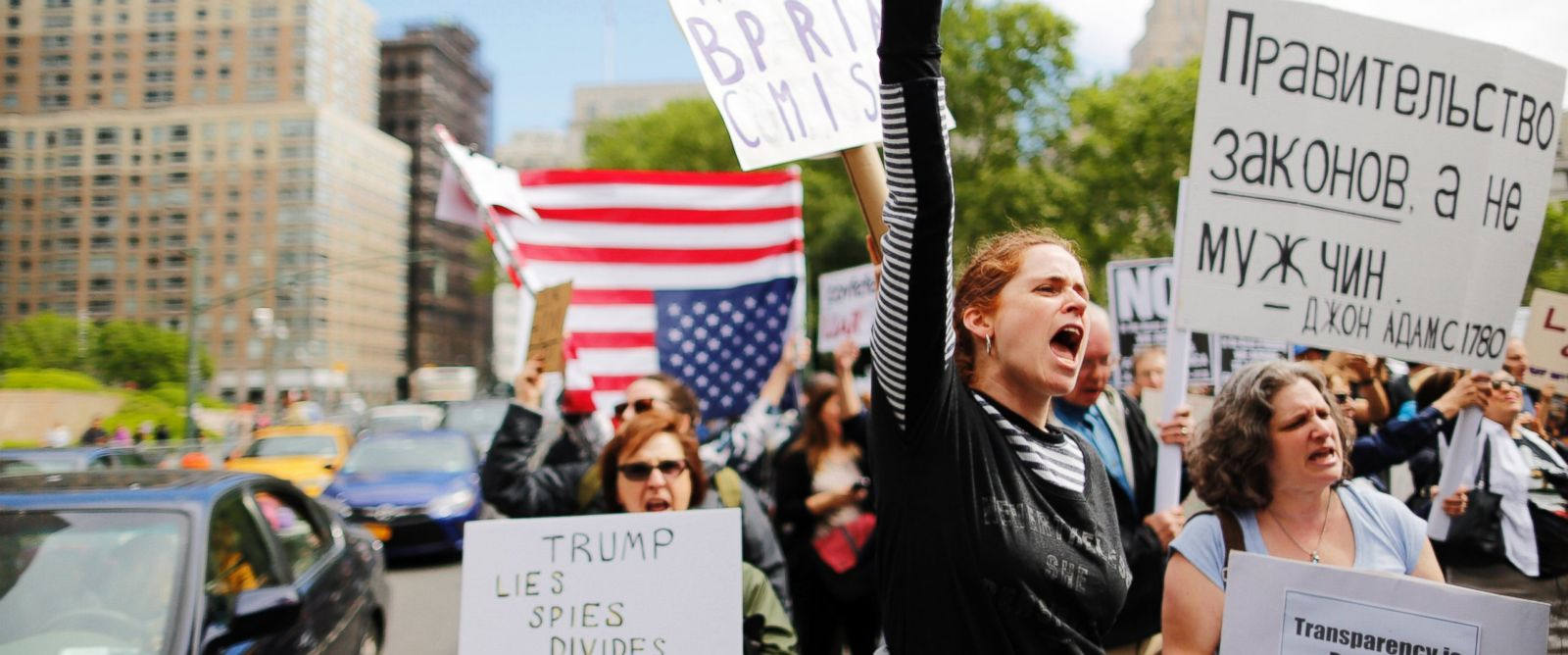 """PHOTO: Demonstrators take part in an anti-Trump """"March for Truth"""" rally at Foley Square on June 3, 2017 in New York City."""