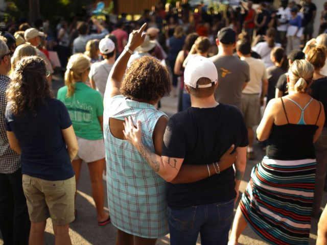 PHOTO: A crowd gathers to remember an Australian woman who was shot and killed late Saturday by police, Sunday evening, July 16, 2017, in Minneapolis.