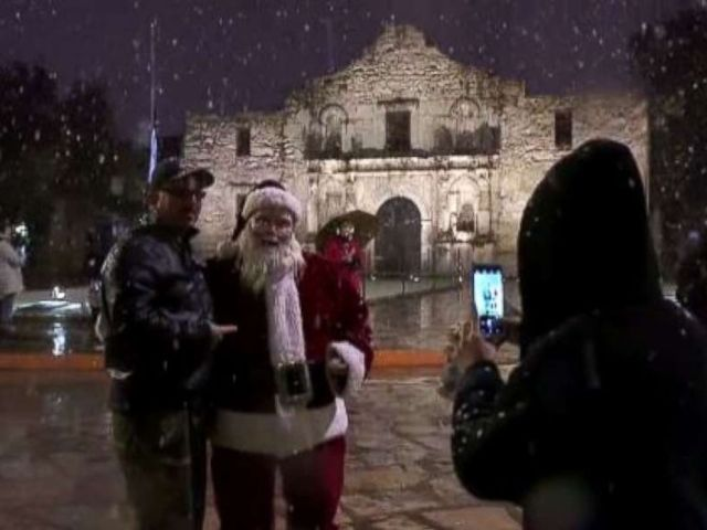 Santa Claus greeted visitors at the Alamo in San Antonio on Thursday evening as rare snow fell in the region.