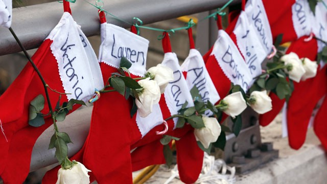 PHOTO:Christmas stockings with the names of shooting victims hang from railing near a makeshift memorial near the town Christmas tree in the Sandy Hook village of Newtown, Conn.