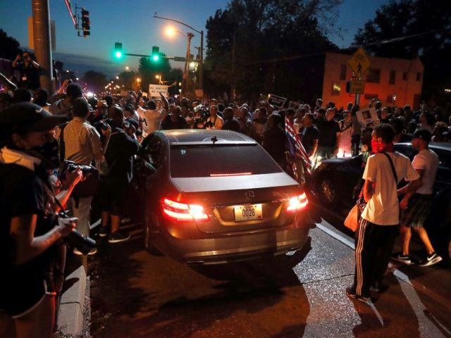 PHOTO: Protesters surround a car as they march in the street response to a not guilty verdict in the trial of former St. Louis police officer Jason Stockley Saturday, Sept. 16, 2017, in St. Louis.