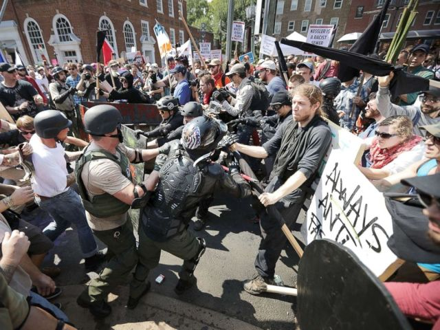 PHOTO: White nationalists, neo-Nazis and members of the alt-right clash with counter-protesters as they enter Lee Park during the Unite the Right rally, Aug. 12, 2017, in Charlottesville, Virginia.