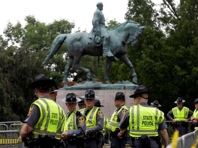 PHOTO: Virginia State Troopers stand under a statue of Robert E. Lee before a white supremacists rally in Charlottesville, Va., Aug. 12, 2017.