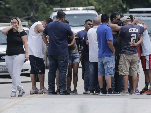 PHOTO: Family members react as a van is pulled out of the Greens Bayou with the bodies of six family members on Wednesday, Aug. 30, 2017, in Houston.