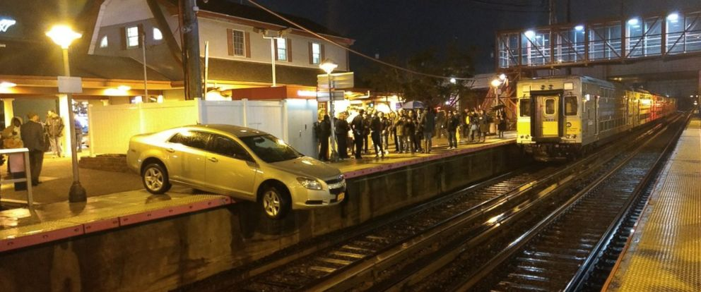A driver ended up dangling off the LIRR platform in Mineola, N.Y. on Saturday, Nov. 18, 2017.