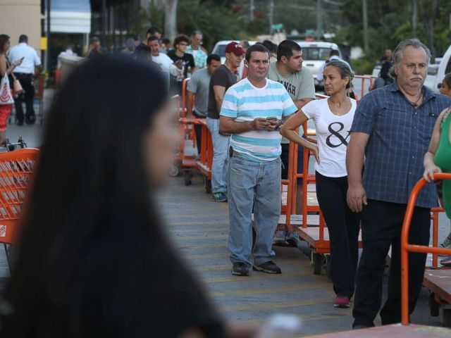 PHOTO: People wait in line to purchase plywood at The Home Depot as they prepare for Hurricane Irma, Sept. 6, 2017, in Miami.
