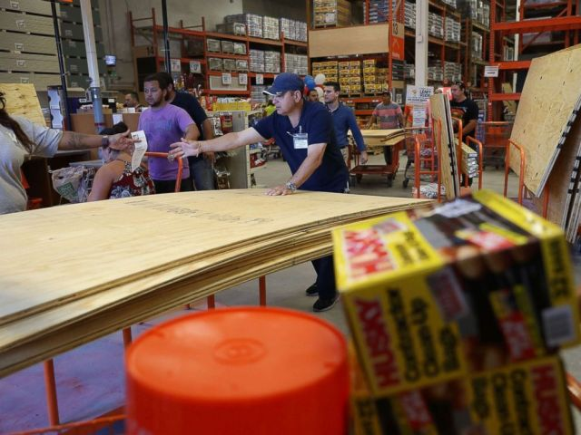 PHOTO: People purchase plywood at The Home Depot as they prepare for Hurricane Irma, Sept. 6, 2017, in Miami.