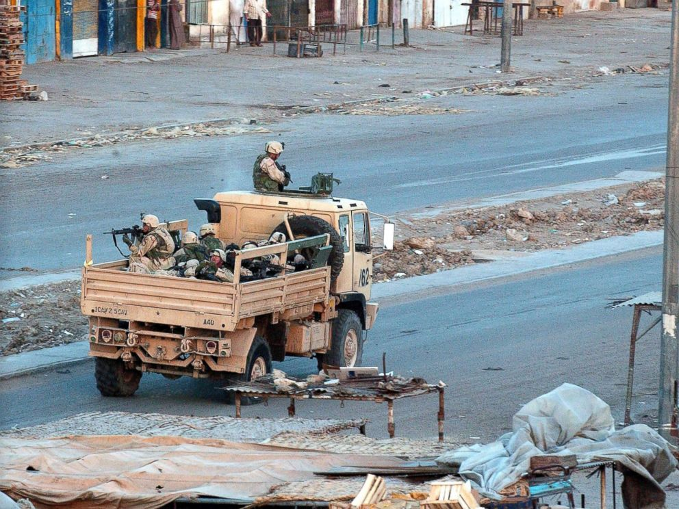 PHOTO: U.S. troops patrol the deserted streets of the sprawling Shia slum of Sadr City at sunset after a day of tense clashes across the country with supporters of controversial Shia cleric Moqtada al-Sadr, April 4, 2004, in Sadr City, Iraq.