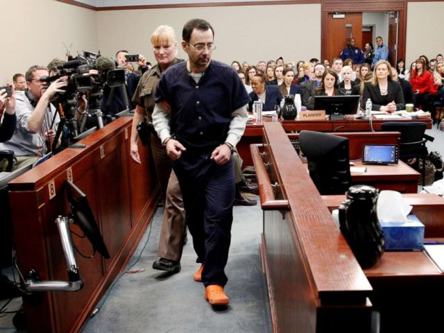 PHOTO: Larry Nassar, a former team USA Gymnastics doctor who pleaded guilty to sexual assault charges, is escorted into the courtroom during his sentencing hearing in Lansing, Mich., on Jan. 24, 2018.