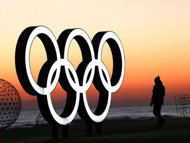 PHOTO: A tourist waits for the sun rise next to the Olympic rings installation near venues of the PyeongChang Winter Olympic Games 2018, in Gangneung, South Korea, Jan. 30, 2018.