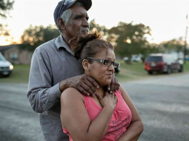 PHOTO: Enrique and Gabby Garcia watch investigators at the scene of a mass shooting at the First Baptist Church in Sutherland Springs, Texas, Nov. 5, 2017.