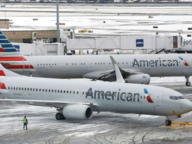 PHOTO: American Airlines passenger planes prepare for takeoff at Boston Logan International Airport in Boston, Mass., on Jan 30, 2018.
