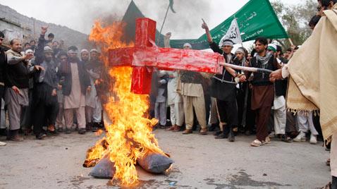 Afghans Burn Cross During Protest