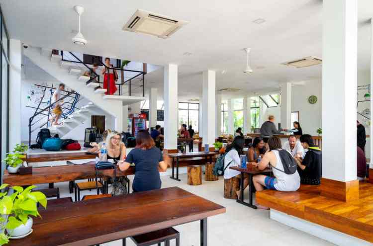 Backpackers, tourists hanging out in common Area at Ondrez Hostel, Siem Reap, Cambodia