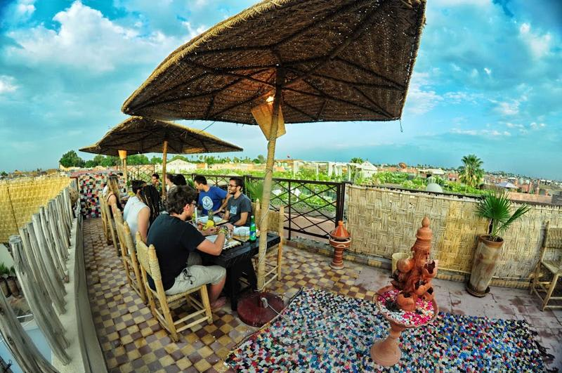 People eating at the terrace of Dream Kasbah Hostel in Marrakech