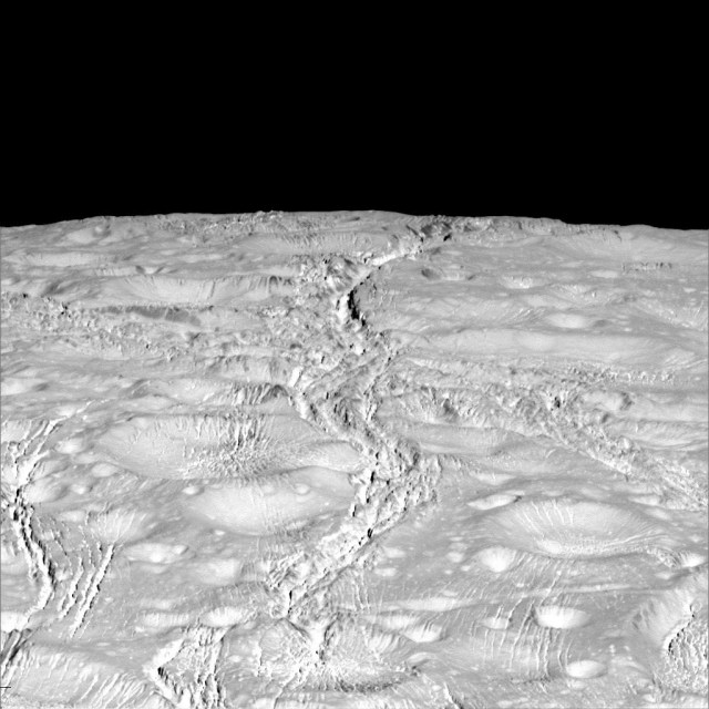 NASA's Cassini spacecraft zoomed by Saturn's icy moon Enceladus on Oct. 14, 2015, capturing this stunning image of the moon's north pole. Scientists expected the north polar region of Enceladus to be heavily cratered, based on low-resolution images from the Voyager mission, but high-resolution Cassini images show a landscape of stark contrasts. Thin cracks cross over the pole, the northernmost extent of a global system of such fractures. Before this Cassini flyby, scientists did not know if the fractures extended so far north on Enceladus. The image was taken in visible green light with the Cassini spacecraft narrow-angle camera. The view was acquired at a distance of approximately 4,000 miles from Enceladus.