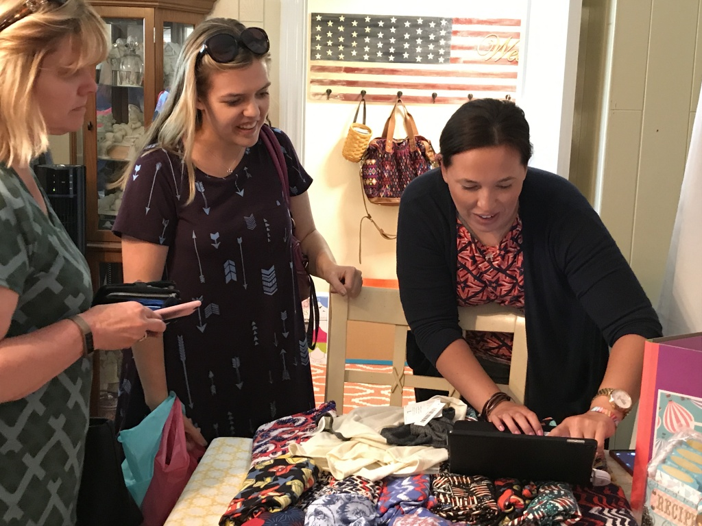 LuLaRoe clothes - Cassandra Carillo rings up a sale using an app on her iPad. - where fashion meets comfort