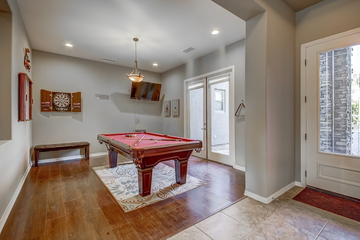 Game room with french doors leading to the pool and spa