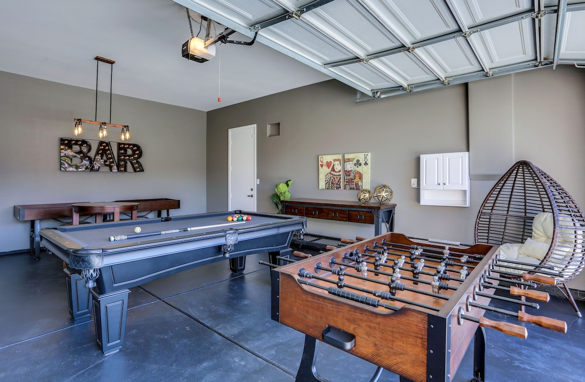 Full game room with shuffle board, billiards, ping pong, foosball, chess/checkers table & more