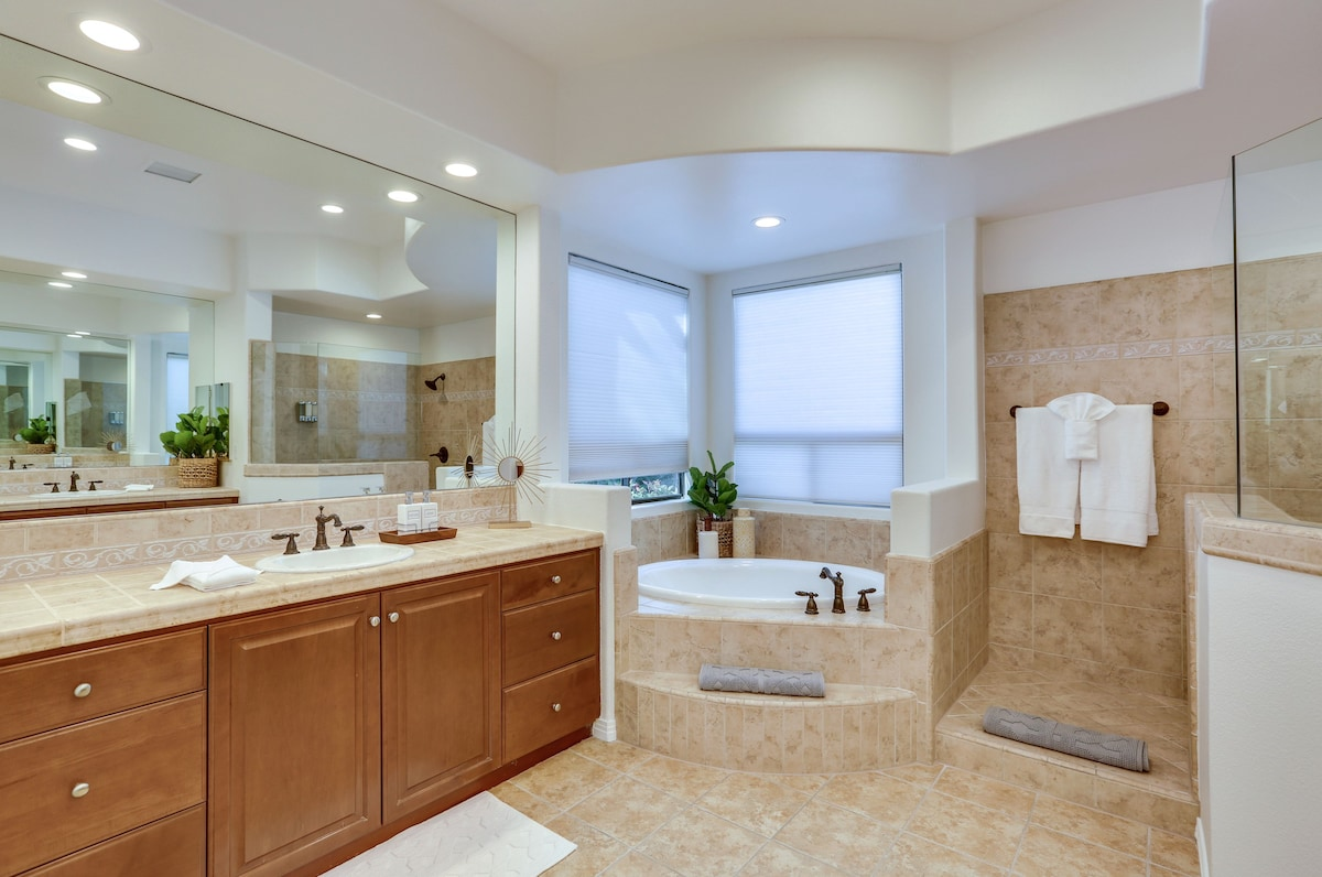 Master bathroom with soaking tub and an oversized tile and glass shower