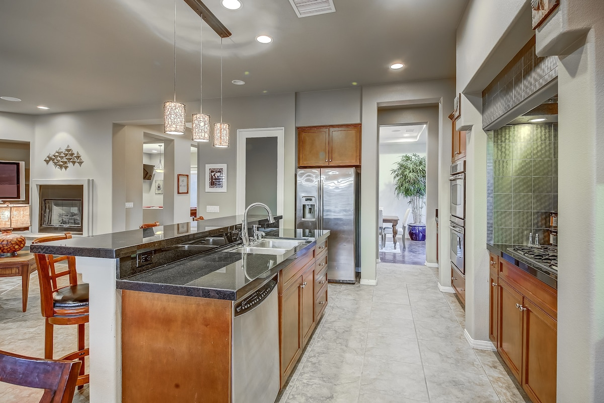 Gourmet kitchen island has seating for 3
