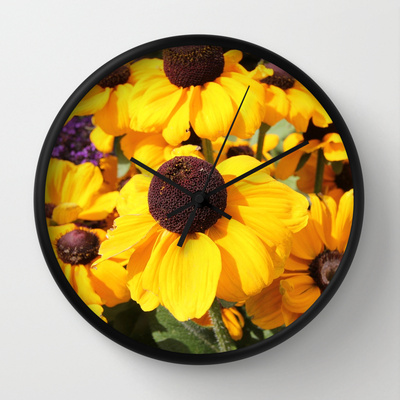 Bright yellow Black-Eyed Susans Wall Clock from Society6