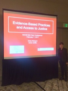 Erika stands proud after the Lab's well-received presentation.