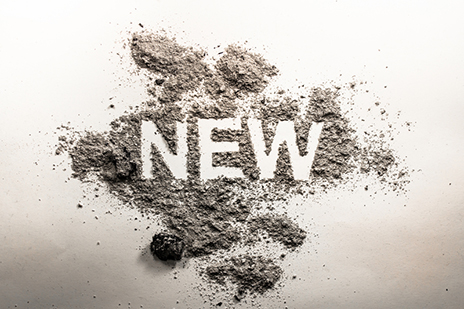 Word new written in ash, dust, dirt as a irony, oxymoron, parado