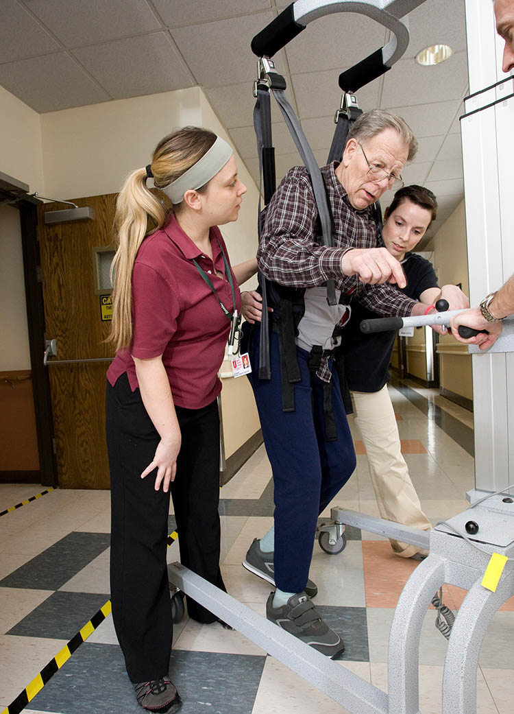 At Kessler Institute for Rehabilitation an individual utilizes a body-weight-support system over ground with addition of manual facilitation, as needed, to minimize errors or compensatory strategies.