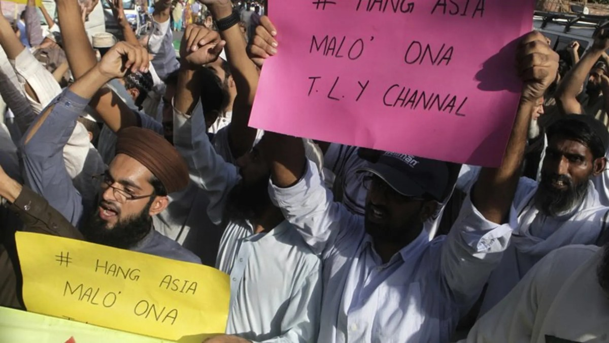 FILE 2016: Supporters of a Pakistani religious group shout slogans demanding thehanging of a Christian woman, Aasia Bibi.