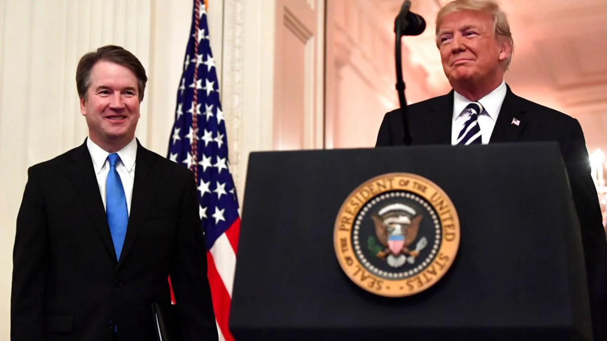 President Donald Trump, right, smiles as he stands with Supreme Court Justice Brett Kavanaugh, left, before a ceremonial swearing in in the East Room of the White House in Washington. (AP Photo/Susan Walsh)
