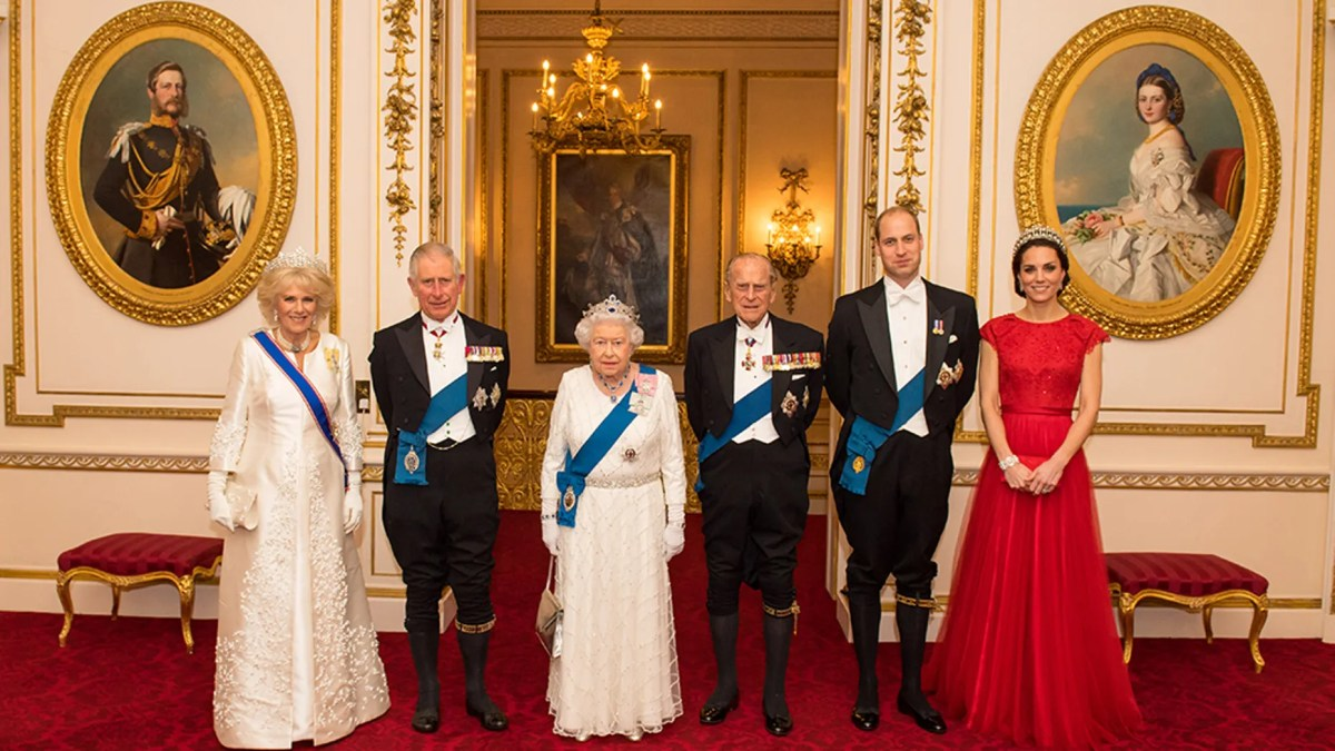 Royal watchers can now apply to work as a sous-chef at Buckingham Palace. Pictured left to right at the famed residence are Camilla, Duchess of Cornwall, Prince Charles, Queen Elizabeth II, Prince Philip, the Duke of Cambridge and the Duchess of Cambridge.