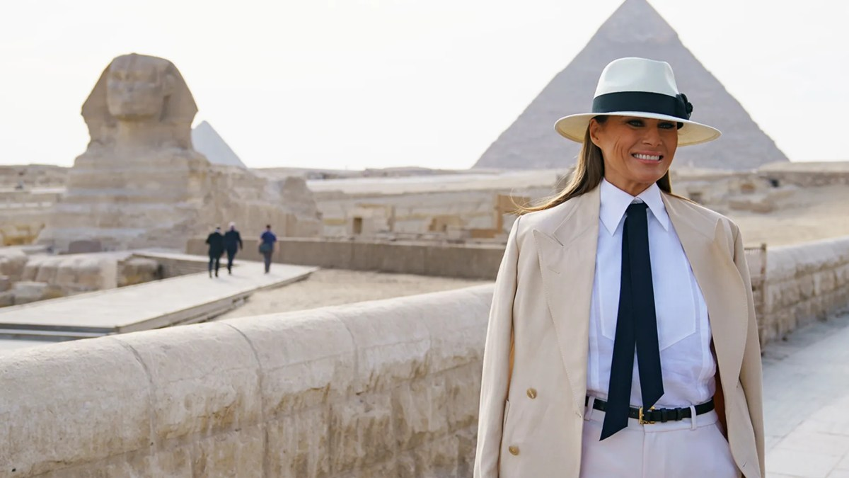 First lady Melania Trump visits the ancient statue of Sphinx, with the body of a lion and a human head, at the historic site of Giza Pyramids in Giza, near Cairo, Egypt, Saturday, Oct. 6