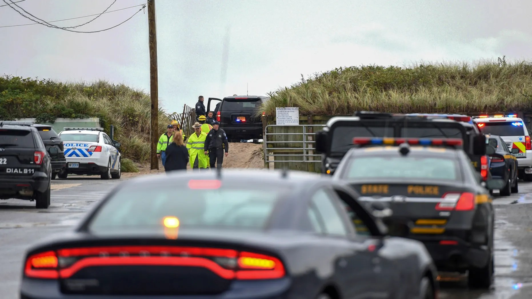 First responders gather on a beach in Quogue, on Long Island, New York, following reports of a plane crashing into the Atlantic on Saturday.