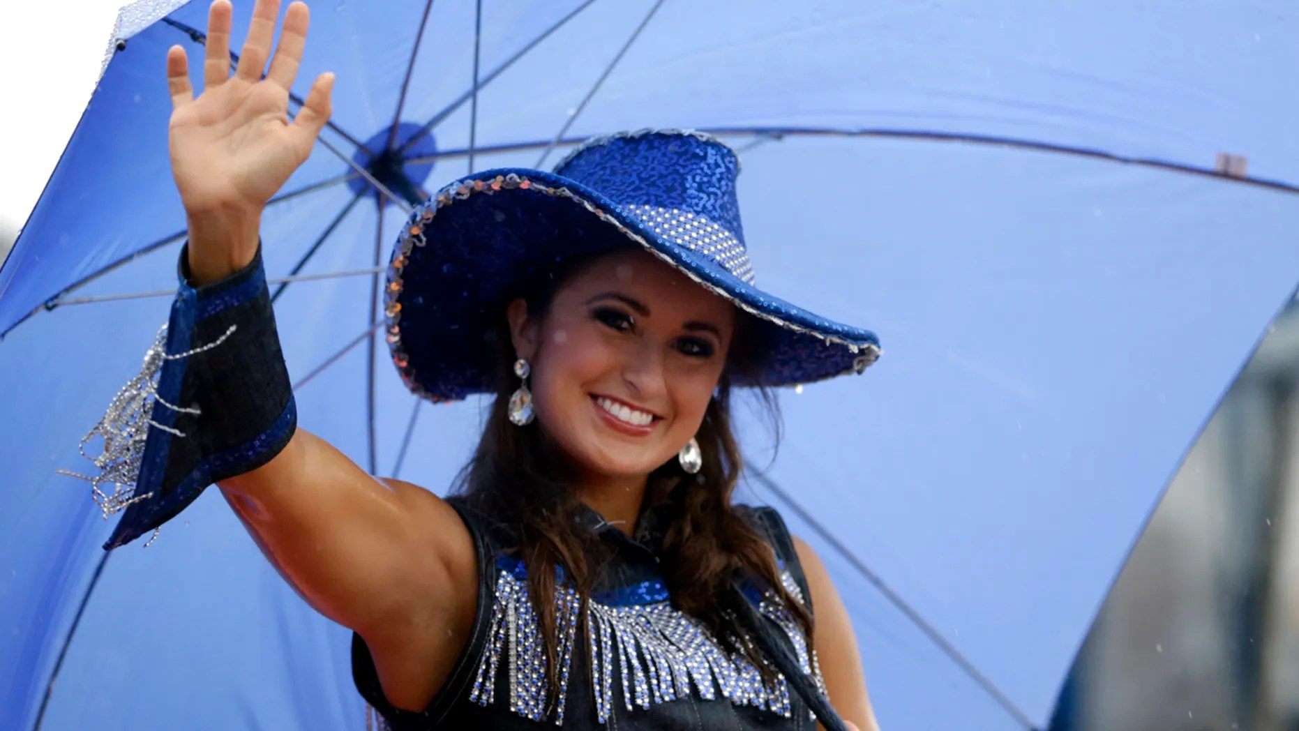 In this Saturday, Sept. 13, 2014 file photo, Miss Kentucky Ramsey Carpenter participates in the Miss America Shoe Parade at the Atlantic City boardwalk in Atlantic City, N.J. (AP Photo/Julio Cortez, File)