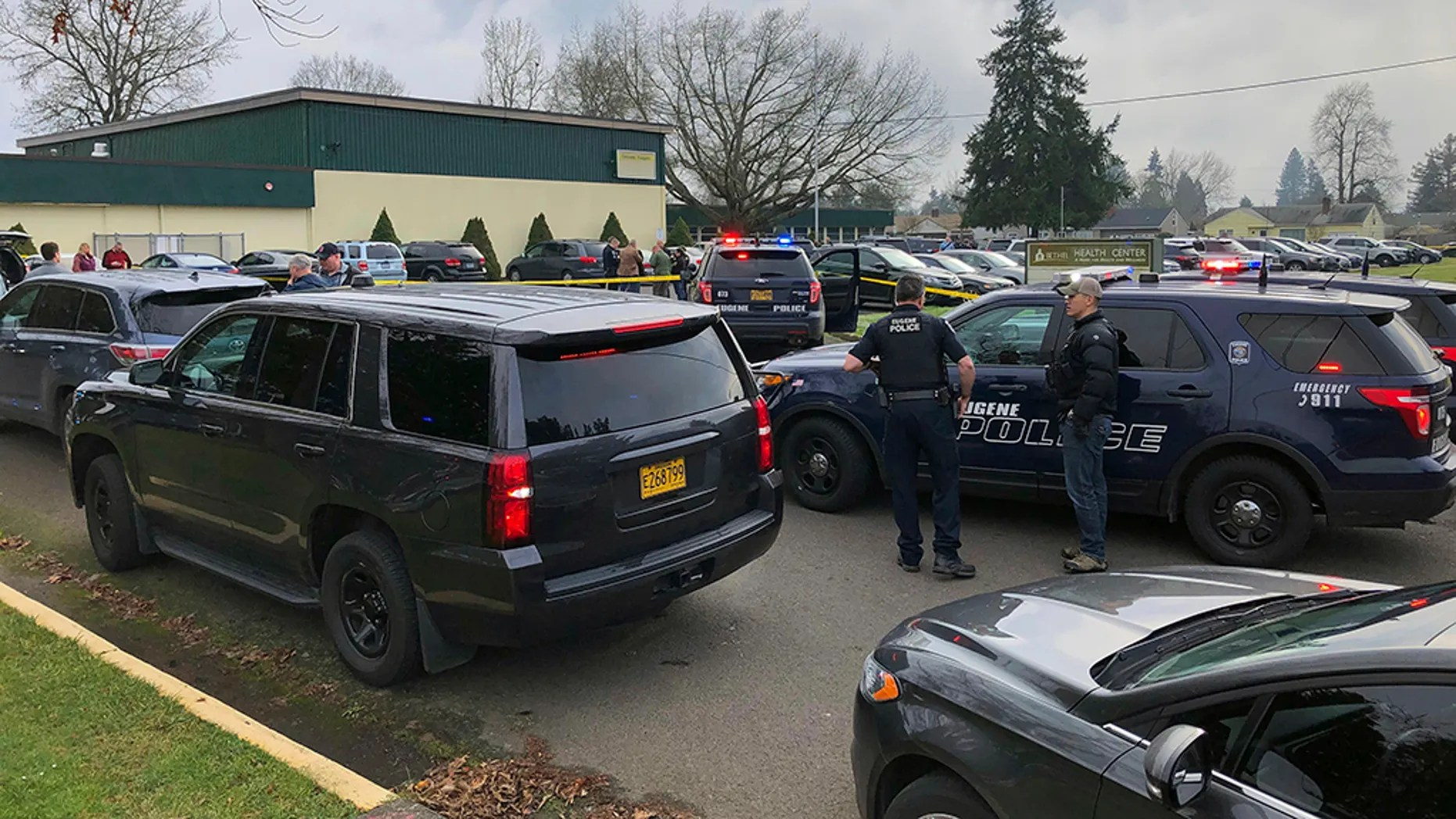 Police officers work the scene where a suspect was shot at a Cascade Middle School in Eugene, Oregon, on Friday. (Chris Pietsch/The Register-Guard via AP)