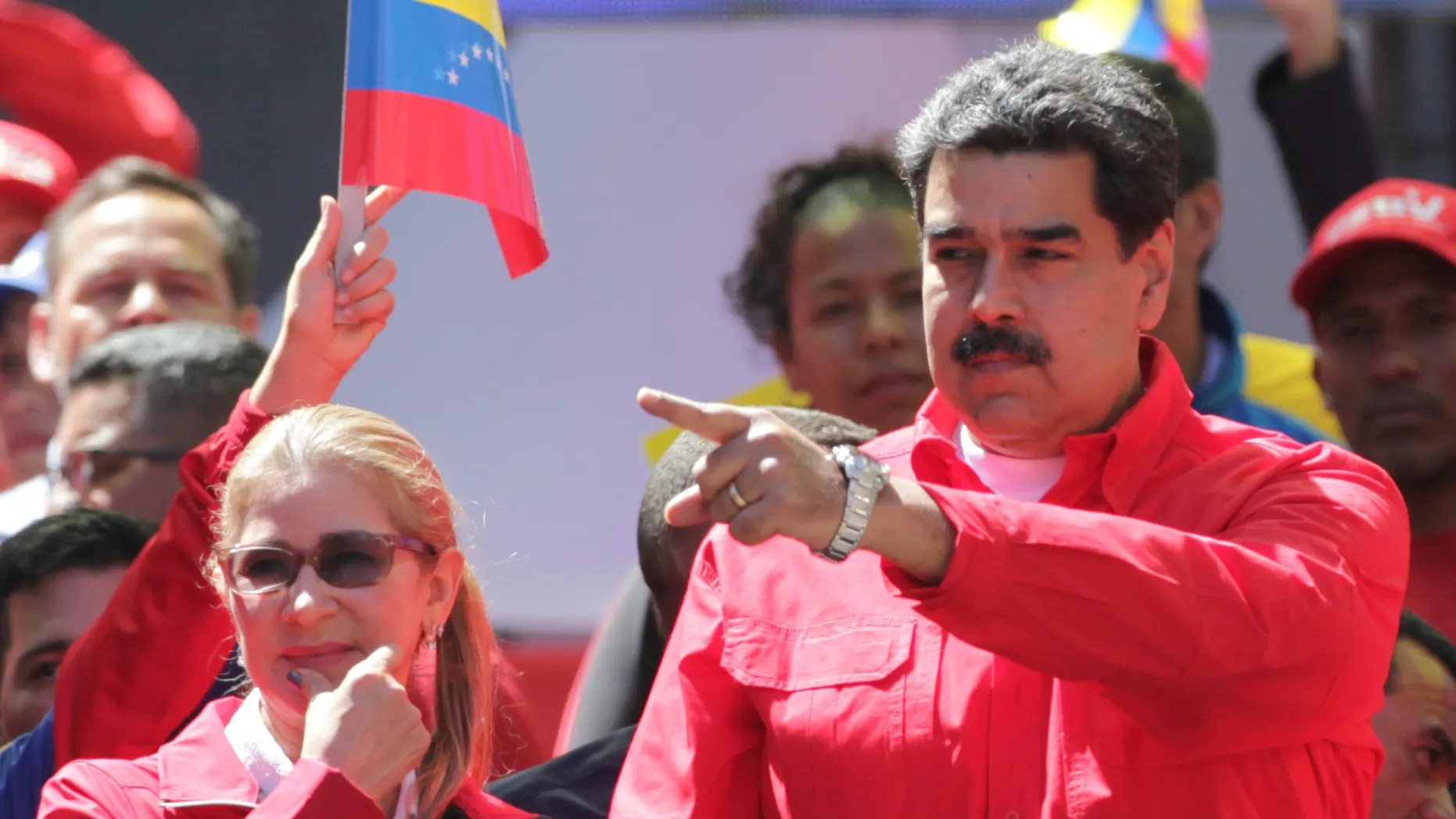 Venezuela's President Nicolas Maduro and first lady Cilia Flores attend a pro-government rally in Caracas, Venezuela, Saturday, Feb. 23, 2019. Maduro has closed Venezuela's borders and calls humanitarian aid destined for Venezuela as part of a U.S.-led coup. (Associated Press)