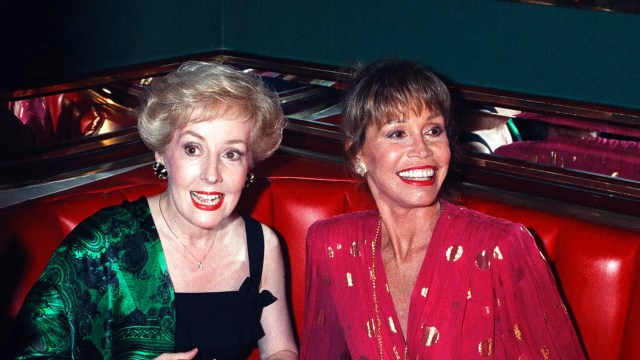 """FILE: Mary Tyler Moore, right, is joined by former """"Mary Tyler Moore Show"""" co-star Georgia Engel, left, at New York's Russian Tea Room at an Emmy Awards screening party in 1992."""