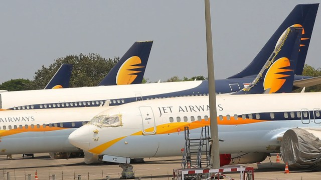 Jet Airways aircrafts are seen parked at Chhatrapati Shivaji Maharaj International Airport in Mumbai, Monday, April 15, 2019. India's ailing Jet Airways has drastically reduced operations amid talks with investors to purchase a controlling stake in the airline and help it reduce its mounting debt. (AP Photo/Rafiq Maqbool)