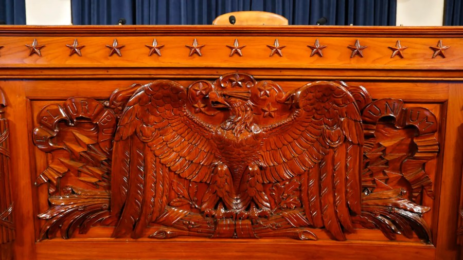 The dais inside the hearing room where the House will begin public impeachment hearings Wednesday, is seen Tuesday, Nov. 12, 2019, on Capitol Hill in Washington. (AP Photo/Jacquelyn Martin)