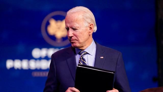 President-elect Joe Biden leaves after speaking at The Queen theater, Dec. 28, in Wilmington, Del. (AP Photo/Andrew Harnik)
