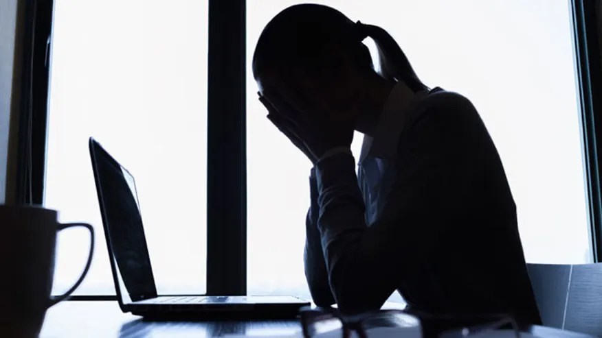 660_depressed_female_worker.jpg