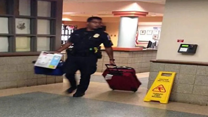Police officer carrying luggage