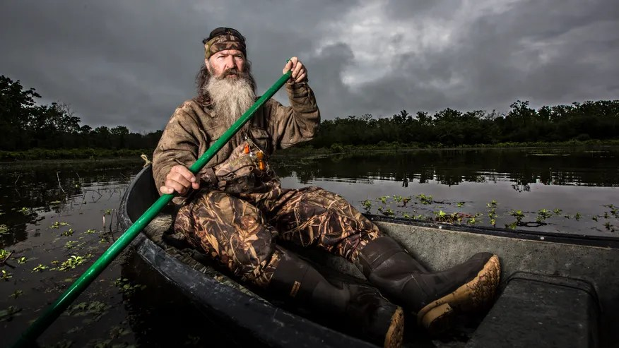 phil robertson in canoe ae.jpg