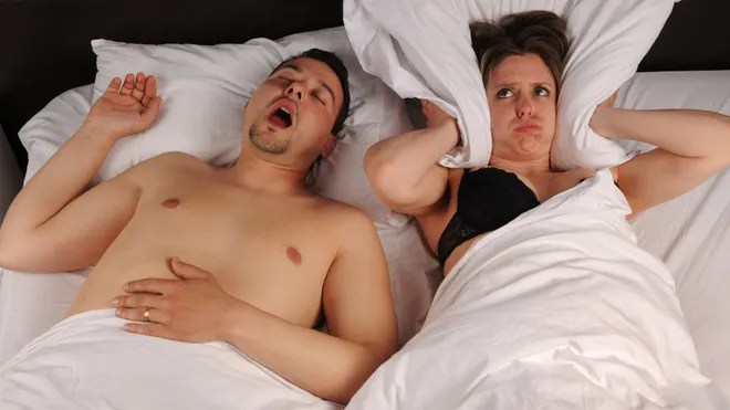 Snoring Couple in Bed
