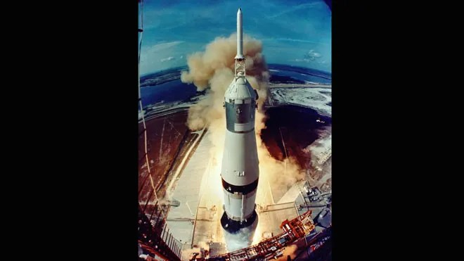 Smoke and flames signal the opening of a historic journey as the Saturn V clears the launch pad. (NASA)