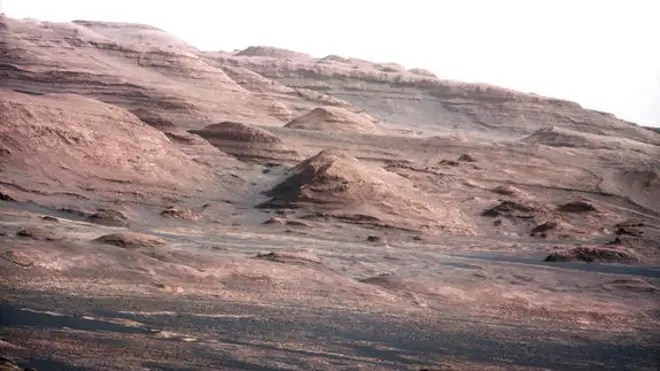 This photo from NASA's Mars rover Curiosity shows the layered geologic history of the base of Mount Sharp, the 3-mile-high mountain rising from the center of Gale Crater. Image taken on Aug. 23, 2012. (NASA/JPL-Caltech/MSSS)